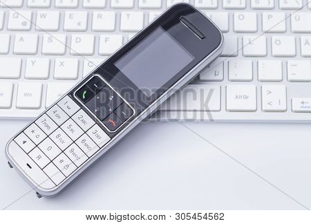 Image Shows A Phone On A White Colored Keyboard Isolated