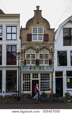 Gouda, Holland, Netherlands, April 23, 2019. The Gouda Old Town, A Street Of Dutch Style Facades Of