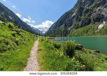 Path Through Spring Mountains Landscape Near Alpine Lake. Stillup, Stillup Lake, Austria, Tyrol