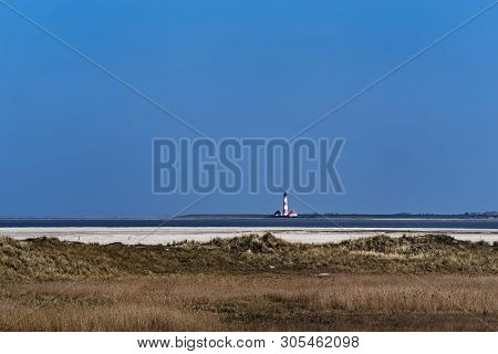 Westerheversand Lighthouse. View From Sankt Peter-ording Beach In North Germany