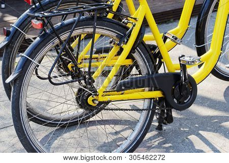 Two Yellow Bicycles At Sunny Day. Sankt Peter-ording, Germany