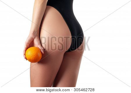 Body Care And Anti Cellulite Massage. Perfect Female Buttocks Without Cellulite With Orange.