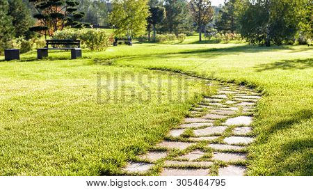 Beautiful Pathway In A Natural Park In Summer. Landscape With Scenic Winding Footpath In Sunlight. S
