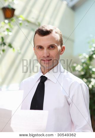 young businessman in the garden