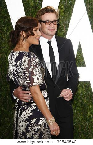 LOS ANGELES - FEB 26:  Rebecca Rigg; Simon Baker arrive at the 2012 Vanity Fair Oscar Party  at the Sunset Tower on February 26, 2012 in West Hollywood, CA