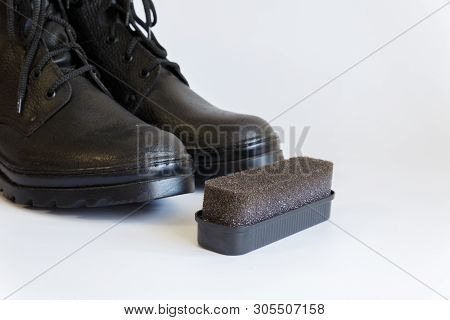 Black shoes and Shoe sponge on white background. Shoe care with a Shoe sponge. Shoe sponge. No people t-shirt