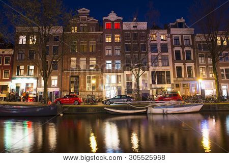 Amsterdam Canals, Night Scene In Old City With Boats And Lights Reflected In Water, Amsterdam, Nethe