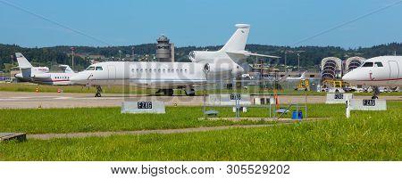 Kloten, Switzerland - June 8, 2019: Airplanes At Zurich Airport,  A Dassault Falcon 7x In The Foregr