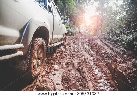 Dirty Offroad Car, Suv Covered With Mud On Countryside Road, Off-road Tires,  Offroad Travel  And Dr