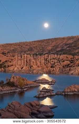 The Full Moon Rising Over Scenic Watson Lake Prescott Arizona