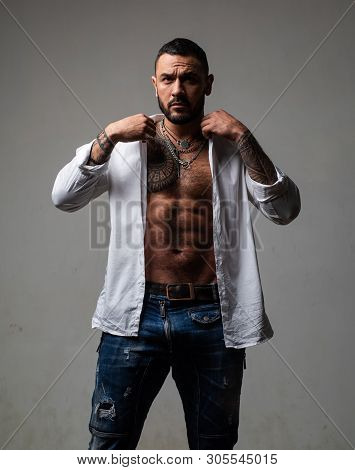 Fashion Portrait Of Young Bearded Man. Looking At Camera Isolated On Gray. Handsome Macho. Brutal Be