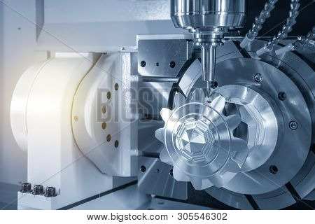The 5-axis Cnc Milling Machine Cutting The Aluminium Gear Parts. The Hi-technology Manufacturing Pro