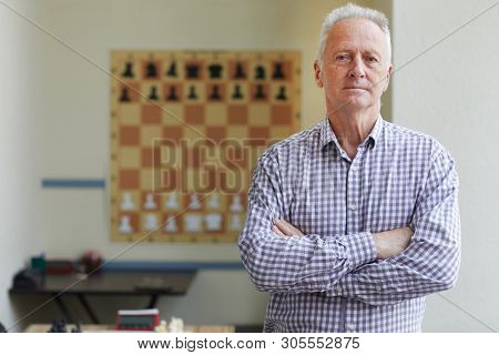 Famous Aged Male Experienced Grandmaster Posing For Pictures After Winning Chess Tournament
