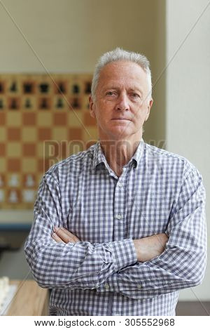 Experienced Professional Grandmaster Posing For Pictures For His Book About Playing Chess