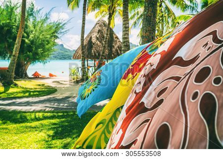 Tahiti vacation background saron pareo tahitian skirts flowing in the wind at beach resort souvenir shop of hotel. Sarong wrap skirt, Tahiti, French Polynesia. Handmade tourism souvenir. poster