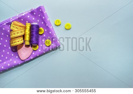 Sewing Accessories And Fabric On A Blue Background. Concept For Needlework, Stiching, Embroidery. Se