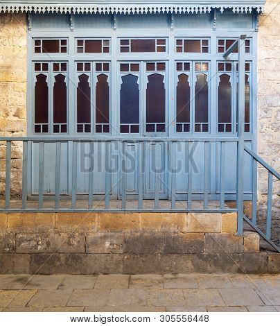 Changing rooms with blue wooden door shutters and wooden balustrades at abandoned historical traditional Turkish public bathhouse (Hamam Inal), Moez Street, Cairo, Egypt poster