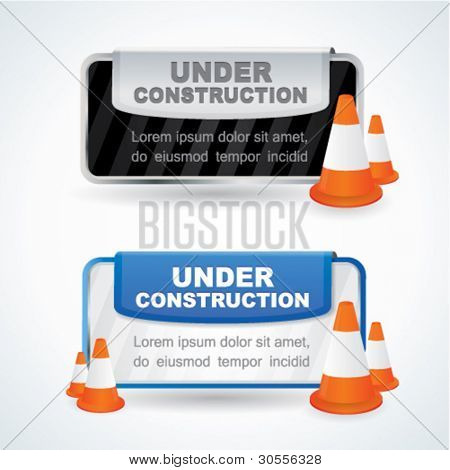 Under construction signs with orange traffic cones