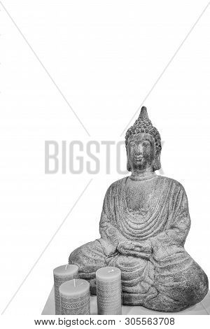 Budha meditating in reflection in white background