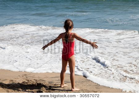Little Girl Waiting For The Ocean Wave