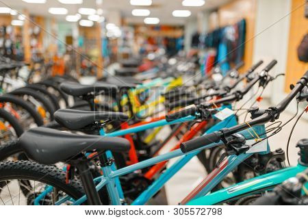 Rows of bicycles in sports shop, focus on seat