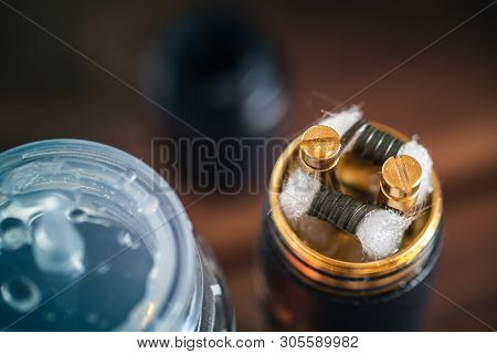 Vape Device Rda With Coils, Cotton And E-liquid Or E- Juice, Macro Photo. Vaping E-cigarette, Altern