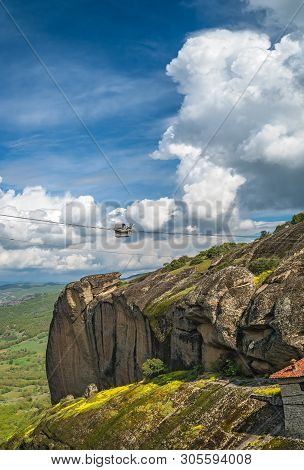 Ropeway Transport Of A Basket Cubicle With Person And Good To The Top Of A Rock Where Holy Monastery