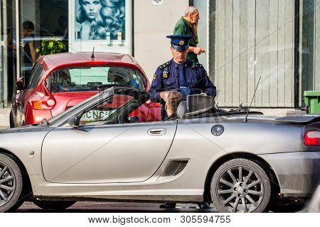 Batumi, Georgia - May 7, 2017. Georgian Police In Uniform Giving A Penalty To Tourist