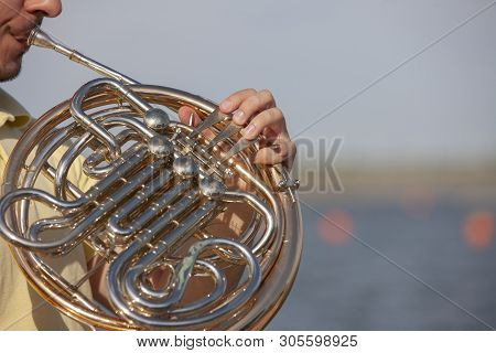 French Horn Instrument. Player Hands Playing Horn Music Brass Instrument