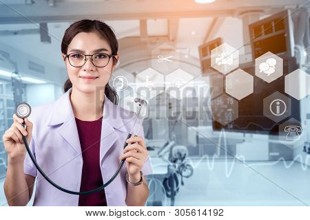 Doctor With A Stethoscope In The Hands And Operating Room Background, Modern Medical Technology And