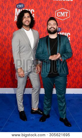 NASHVILLE - JUN 5: Dan Smyers (L) and Shay Mooney of Dan + Shay attend the 2019 CMT Music Awards at the Bridgestone Arena on June 5, 2019 in Nashville, Tennessee.