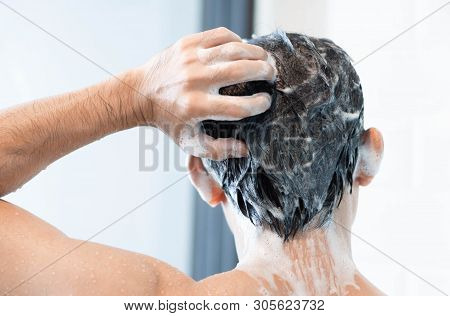 Closeup Young Man Washing Hair With With Shampoo In The Bathroom, Health Care Concept, Selective Foc