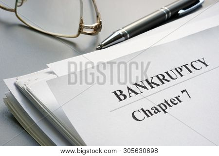 Chapter 7 Bankruptcy Petition With Pen And Glasses.