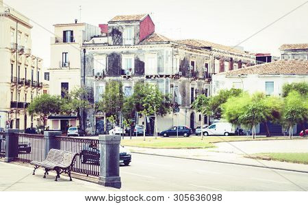 Tipical Street With Metal Benches In Catania, Sicily, Southern Italy