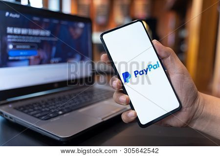 Chiang Mai, Thailand - May.01,2019: Man Holding Xiaomi Mi Mix 3 With Paypal Apps On The Screen. Payp