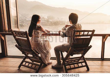 Asian Couple Drinking Tea Sunrise At Lee Wine Rak Thai, Chinese Settlement, Mae Hong Son, Thailand