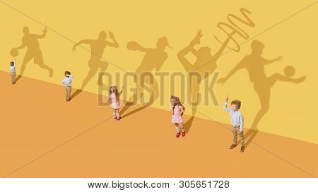 Childhood And Dream Concept. Conceptual Image With Children And Shadow On The Yellow Studio Wall. Li