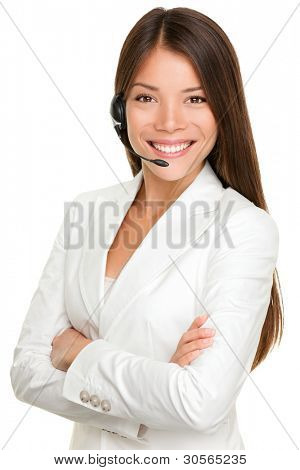 Telemarketing headset woman from call center smiling happy talking in hands free headset device. Multicultural mixed race Chinese Asian / Caucasian business woman in suit isolated on white background.