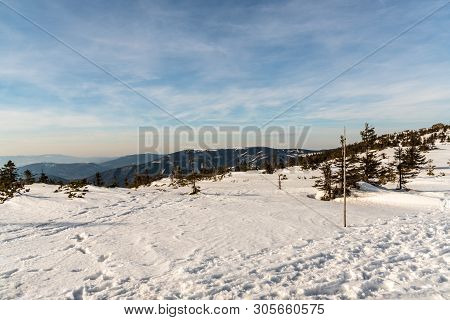 view to west and southwest from Pec hill on main ridge of Jeseniky mountains in Czech republic during winter day with blue sky poster