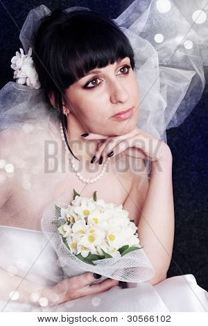 Beautiful bride in bridal veil with the bouquet poster