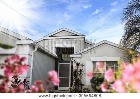 close up shot of family home exterior over sky in Florida