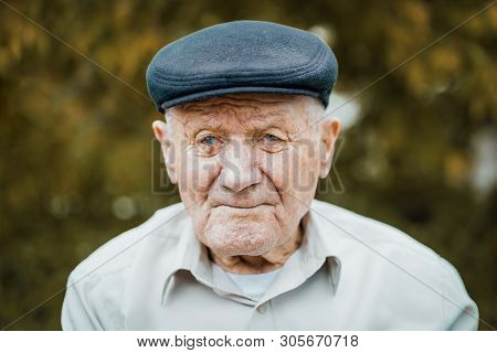 Very Old Caucasian Man Portrait. Grandfather In Hat. Portrait: Aged, Elderly, Loneliness, Senior Wit