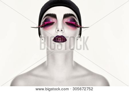 Portrait Of Young Beautiful Model With White Skin And Surreal Makeup