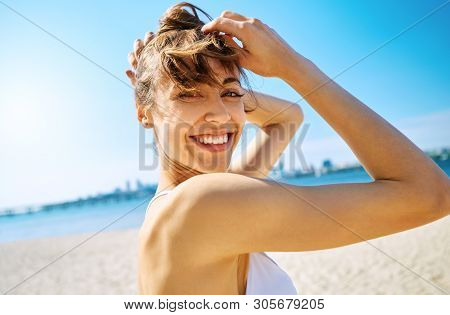Close Up Portrait Of Beautiful Sexy Happy Woman On The Sand City Beach With Sea Background. Summerti