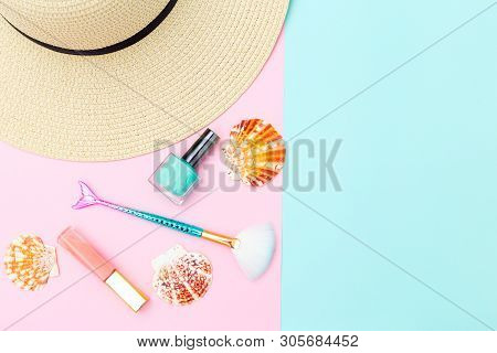 Feminine Travel And Beauty Accessories On Paslels Color Background. Copy Space