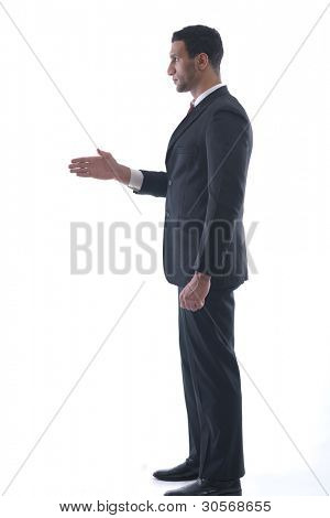 Confident business man giving you a hand shake on white background representing concept of success and cooperation