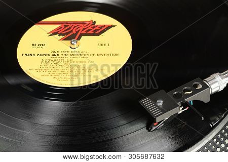 London, England - May 08, 2019: Vintage Vinyl Record With Discreet Label Played On Turntable With Au
