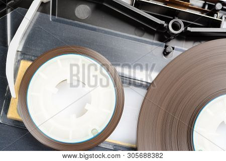 Audio Cassette With Removed One Of The Covers. You Can See Precision Tape Drive Mechanism