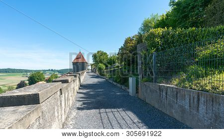 Romont, Fr / Switzerland - 1 June 2019: Historic Medieval City Walls With Guard Tower In Romont In C