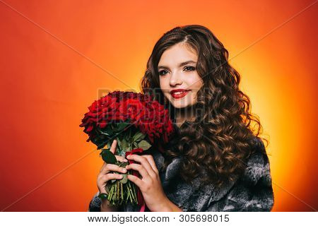 The Day Of Warm Feelings And Excitement. Young Woman Smile With Fresh Flowers. Happy Woman Hold Red